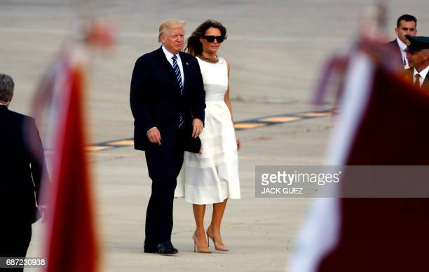 President Donald Trump and First Lady Melania Trump walk on the runway as they prepare to board Air Force One before departing from Ben Gurion...