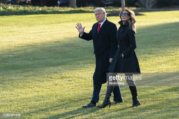 President Donald Trump and First Lady Melania Trump walk on the South Lawn of the White House before boarding Marine One in Washington, D.C., U.S.,...