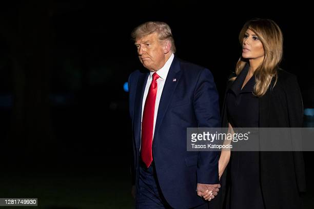 President Donald Trump and first lady Melania Trump walk on the south lawn of the White House on October 23, 2020 in Washington, DC. The Trumps were...