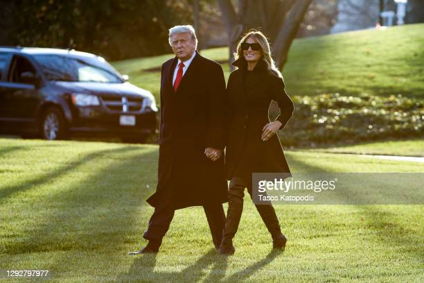 President Donald Trump and first lady Melania Trump walk on the south lawn of the White House on December 23, 2020 in Washington, DC. The Trumps are...