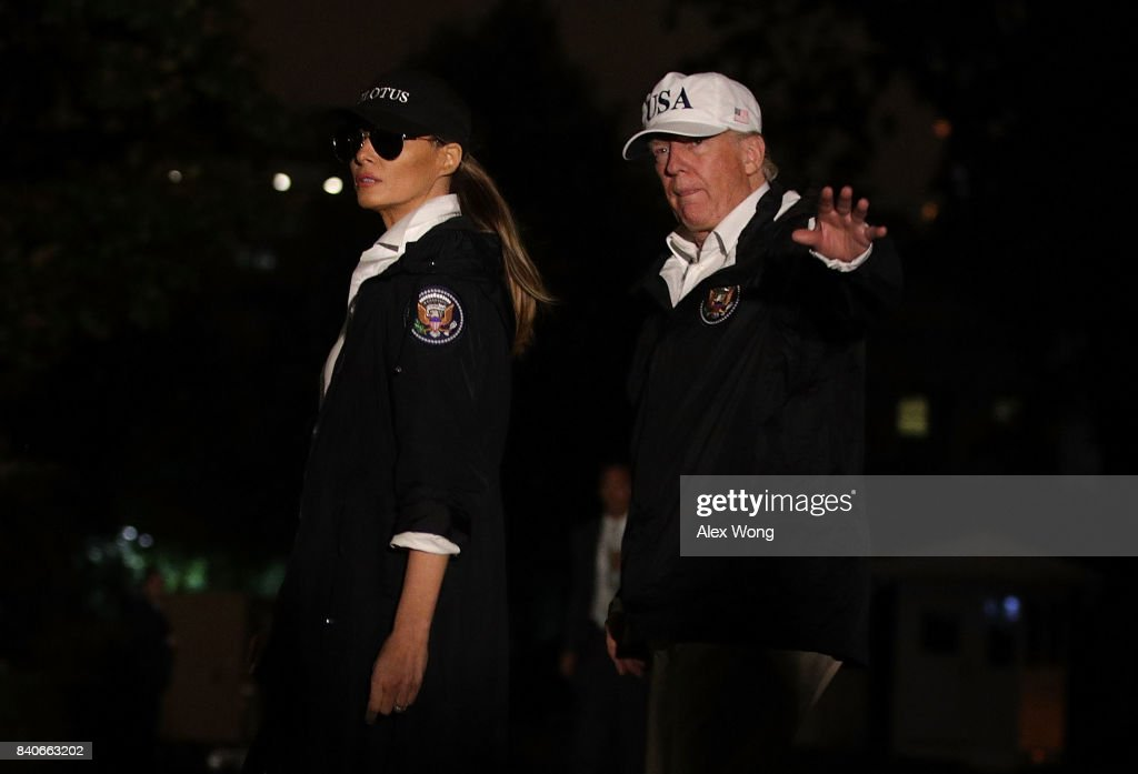 U.S. President Donald Trump and first lady Melania Trump walk on the South Lawn after they returned to the White House August 29, 2017 in Washington, DC. President Trump has returned from Texas where he observed Hurricane Harvey relief efforts.