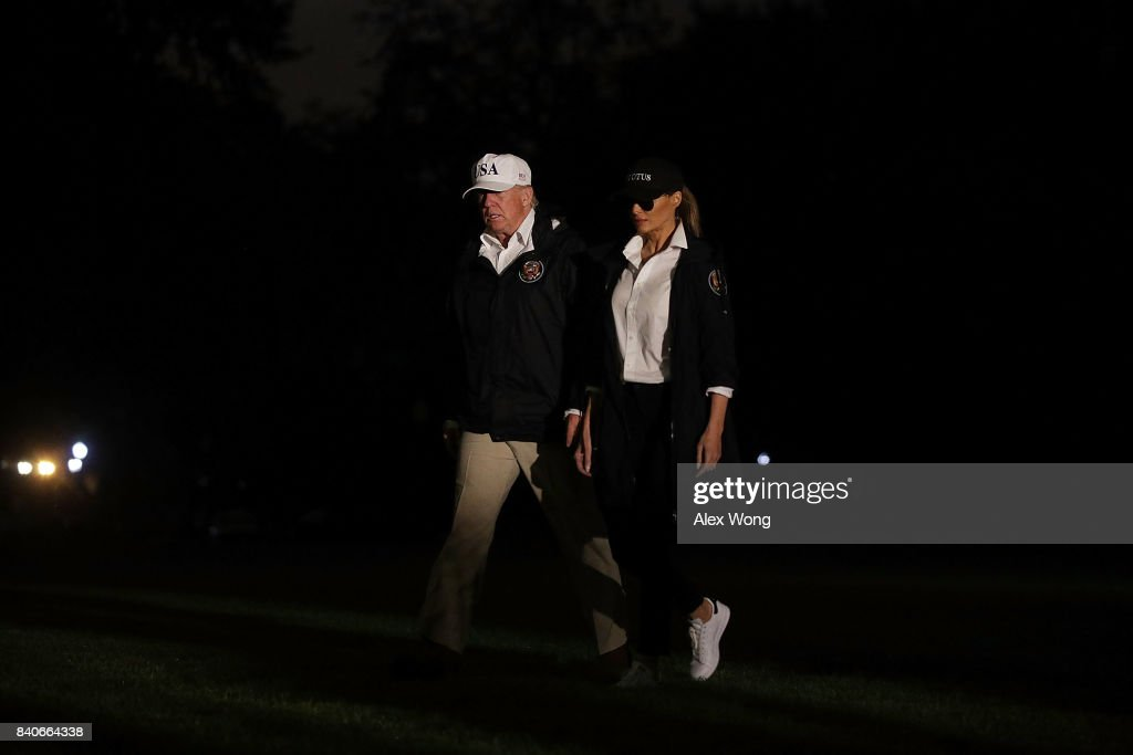 U.S. President Donald Trump and first lady Melania Trump walk on the South Lawn after they returned to the White House August 29, 2017 in Washington, DC. President Trump has returned from Texas after observing the Hurricane Harvey relief efforts.