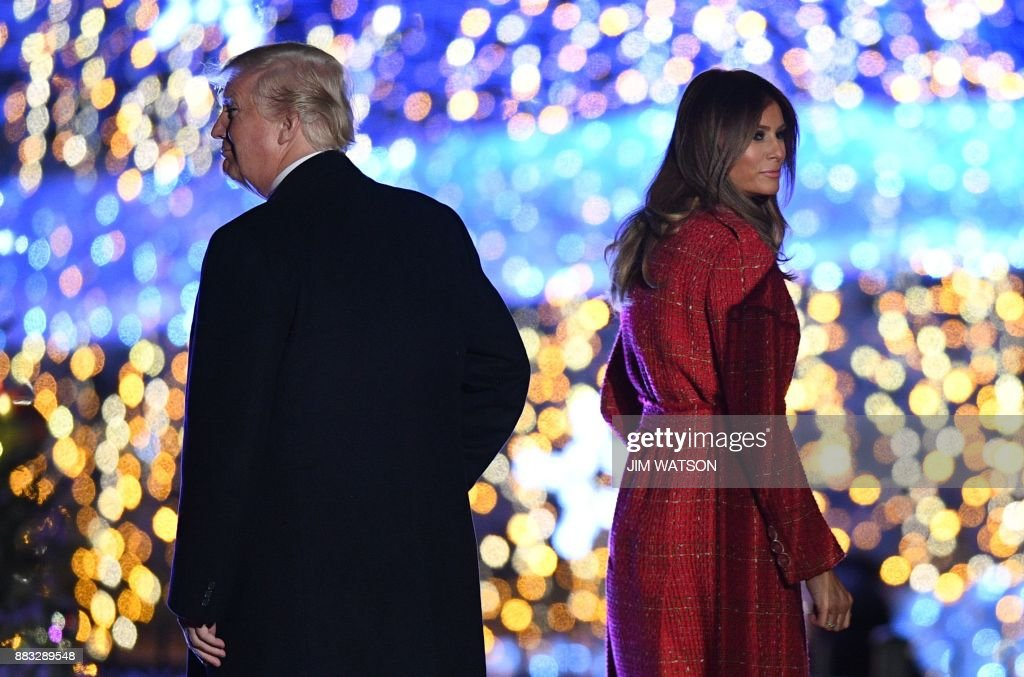 President Donald Trump and First Lady Melania Trump walk on the stage during the 95th annual National Christmas Tree Lighting ceremony at the Ellipse in President's Park near the White House in Washington, DC on November 30, 2017. /