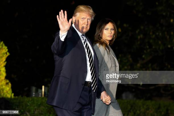 S President Donald Trump and First Lady Melania Trump walk out from the White House to board Marine One for an event at Joint Base Andrews on May...