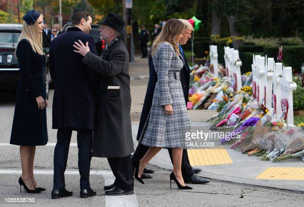 US President Donald Trump and First Lady Melania Trump walk past a memorial as Jared Kushner and Ivanka Trump speak with Rabbi Jeffrey Myers as they...