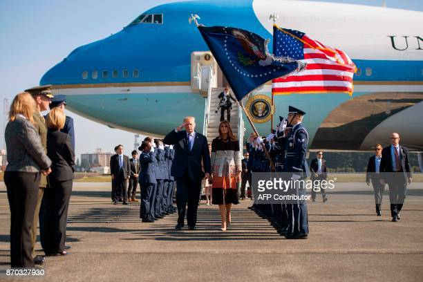 President Donald Trump and First Lady Melania Trump walk through an honour cordon as they arrive at Yokota Air Base at Fussa in Tokyo on November 5...