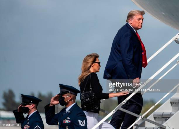 President Donald Trump , and first lady Melania Trump walk to Airforce One as they depart from Palm Beach International Airport in West Palm Beach,...
