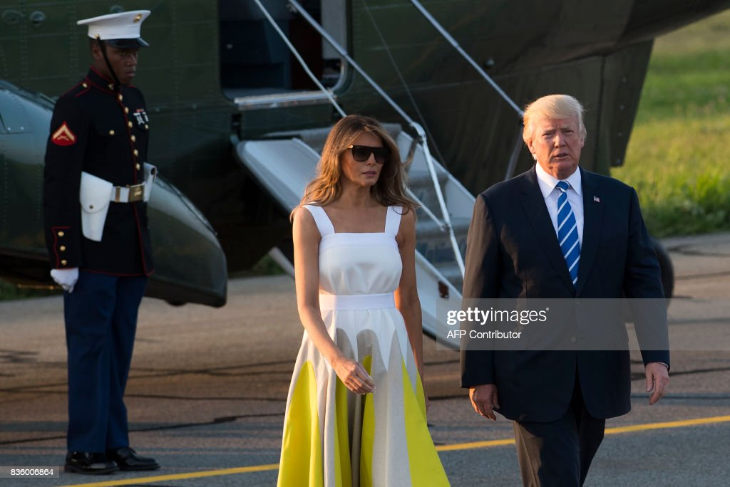 US President Donald Trump and First Lady Melania Trump walk to board Air Force One prior to departure from Morristown Municipal Airport in Morristown, New Jersey, August 20, 2017, as Trump returns to Washington, DC, following a 17-day vacation at his property in Bedminster, New Jersey. /