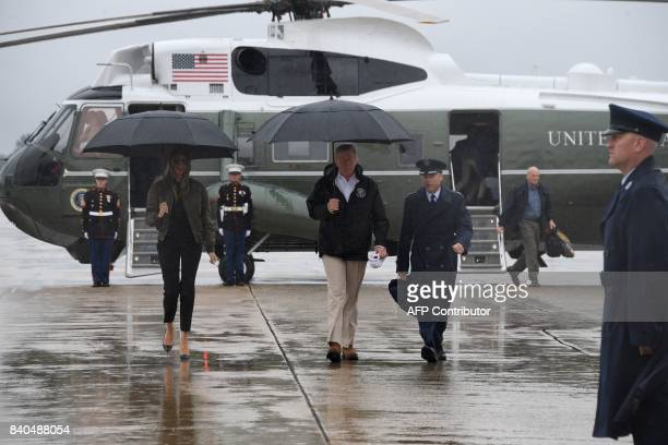 US President Donald Trump and First Lady Melania Trump walk to board Air Force One at Andrews Air Force Base Maryland on August 29 2017 en route to...