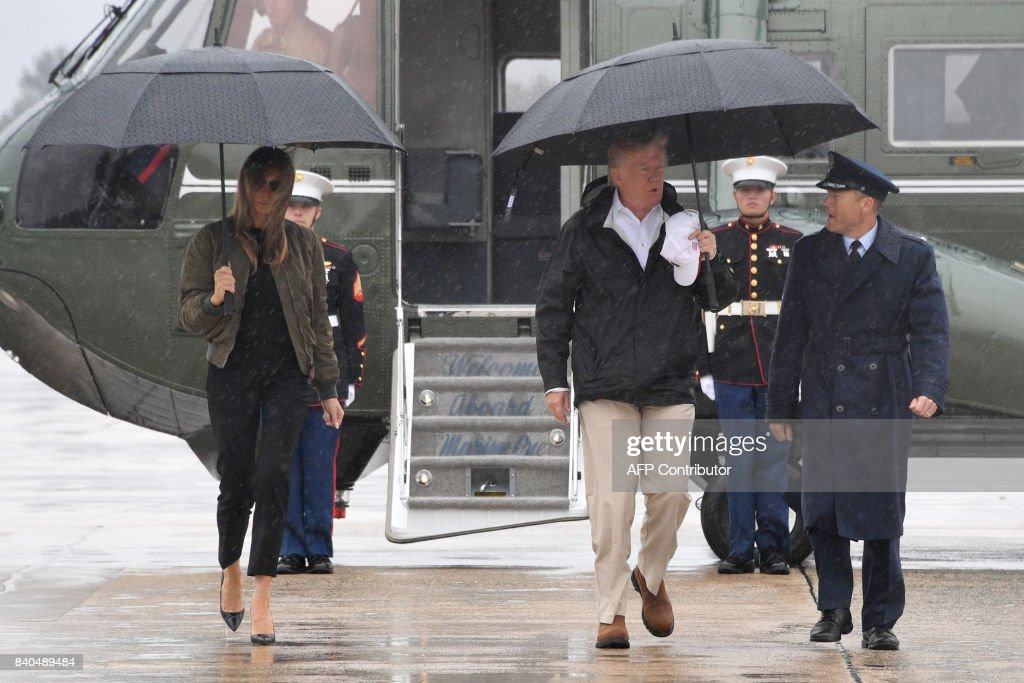 President Donald Trump and First Lady Melania Trump walk to board Air Force One at Andrews Air Force Base, Maryland, on August 29, 2017 en route to Texas to view the damage caused by Hurricane Harvey. /