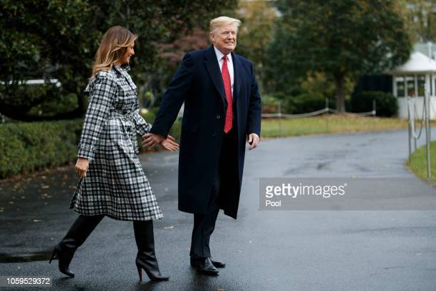 US President Donald Trump and First Lady Melania Trump walk to board Marine One on the South Lawn of the White House on November 9 2018 in Washington...