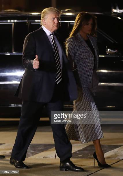 President Donald Trump and First Lady Melania Trump walk to greet the three Americans just released from North Korea Kim Dong Chul Kim Haksong and...