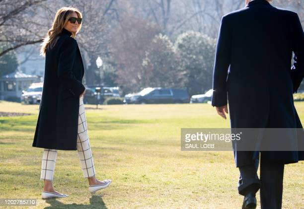 US President Donald Trump and First Lady Melania Trump walk to Marine One prior to departure from the South Lawn of the White House in Washington DC...