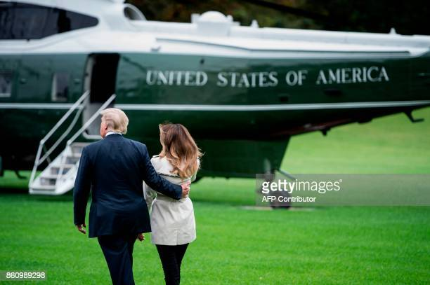 US President Donald Trump and first lady Melania Trump walk to Marine One on the South Lawn of the White House in Washington DC on October 13 2017...