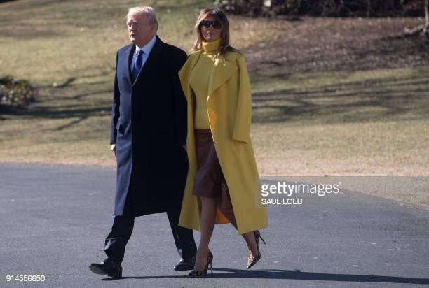US President Donald Trump and First Lady Melania Trump walk to Marine One upon prior to departure from the South Lawn of the White House in...