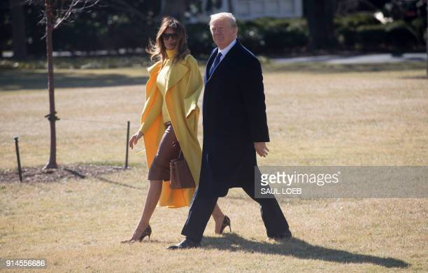 President Donald Trump and First Lady Melania Trump walk to Marine One upon prior to departure from the South Lawn of the White House in Washington...