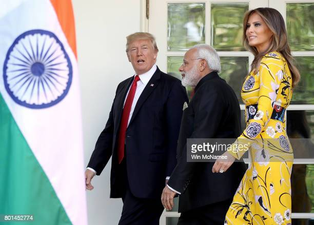 S President Donald Trump and first lady Melania Trump walk to the Oval Office with Indian Prime Minister Narendra Modi at the White House June 26...