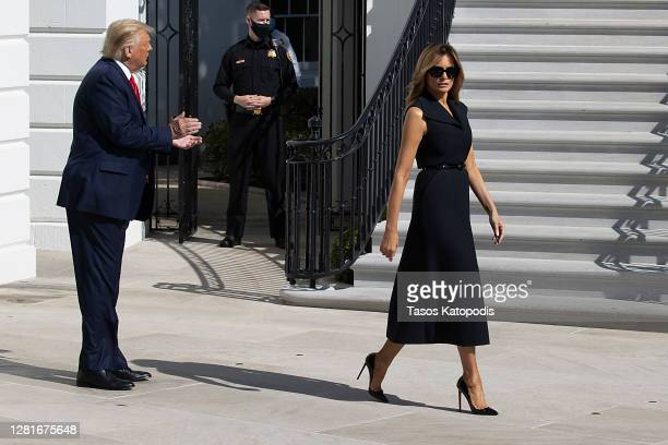 President Donald Trump and First Lady Melania Trump walk to the South Lawn to depart the White House on October 22, 2020 in Washington, DC. President...