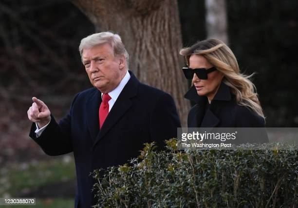 President Donald Trump and First Lady Melania Trump walk towards Marine One on the South Lawn of the White House on their way to Joint Base Andrews...