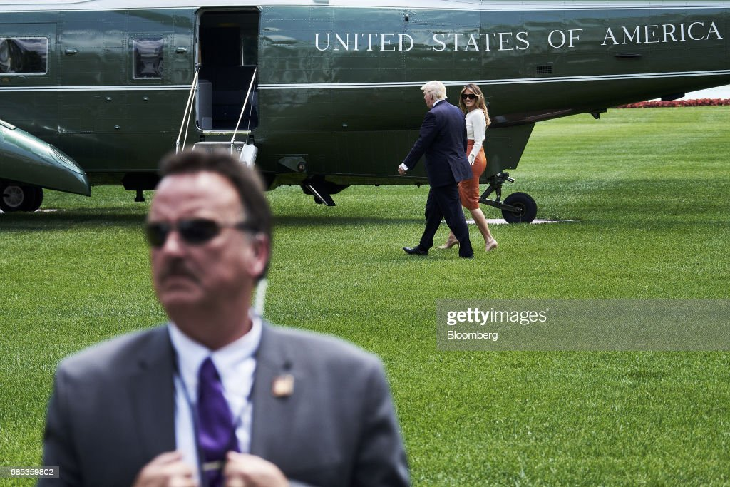 U.S. President Donald Trump and First Lady Melania Trump walk towards Marine One on the South Lawn of the White House in Washington, D.C., U.S., on Friday, May 19, 2017. Trumpdeparted Friday for his first foreign trip as president with his White House engulfed in crisis and little prospect for a break from the drama disrupting his agenda. Photographer: T.J. Kirkpatrick/Bloomberg via Getty Images