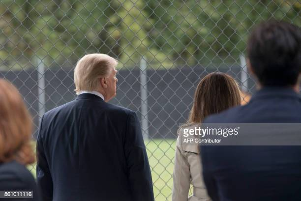 President Donald Trump and First Lady Melania Trump watch a K-9 dog demonstration at the United States Secret Service James J. Rowley training...