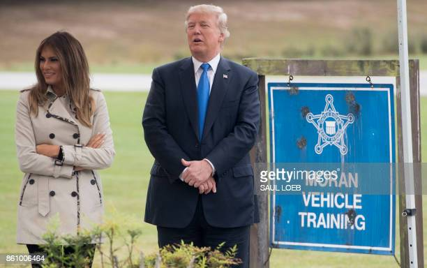 President Donald Trump and First Lady Melania Trump watch a vehicle demonstration at the United States Secret Service James J. Rowley training...