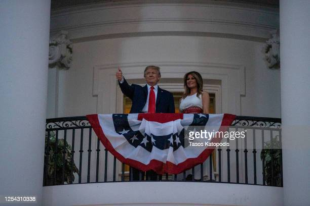 President Donald Trump and first Lady Melania Trump watch fireworks at the White House on July 04 2020 in Washington DC President Trump is hosting a...