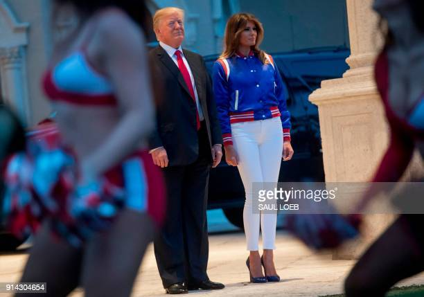 President Donald Trump and First Lady Melania Trump watch the Florida Atlantic University Marching Band perform prior to a Super Bowl party at Trump...