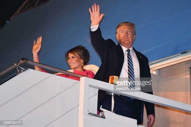 US President Donald Trump and First Lady Melania Trump wave as they board Air Force One at Palam Air Force Airport in New Delhi on February 25 2020