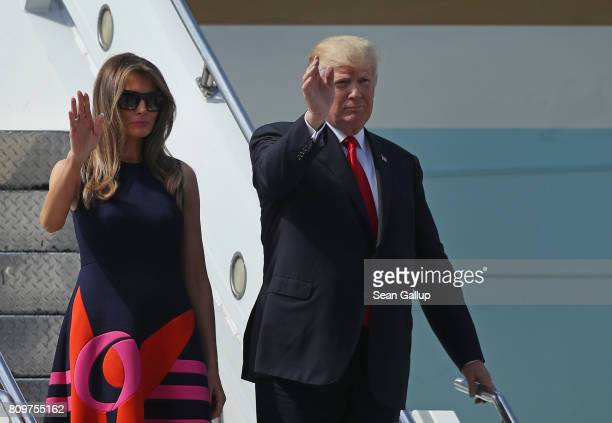 S President Donald Trump and First Lady Melania Trump wave as they arrive at Hamburg Airport for the Hamburg G20 economic summit on July 6 2017 in...