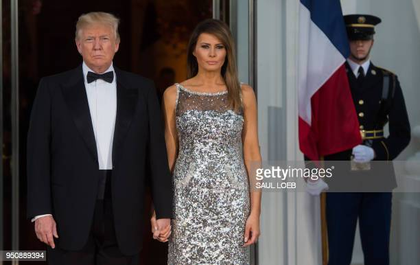 President Donald Trump and First Lady Melania Trump welcome French President Emmanuel Macron and his wife Brigitte Macron as they arrive for a State...