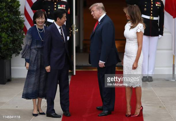 S President Donald Trump and first lady Melania Trump welcome Japanese Prime Minister Shinzo Abe and his wife Akie Abe to the White House April 26...