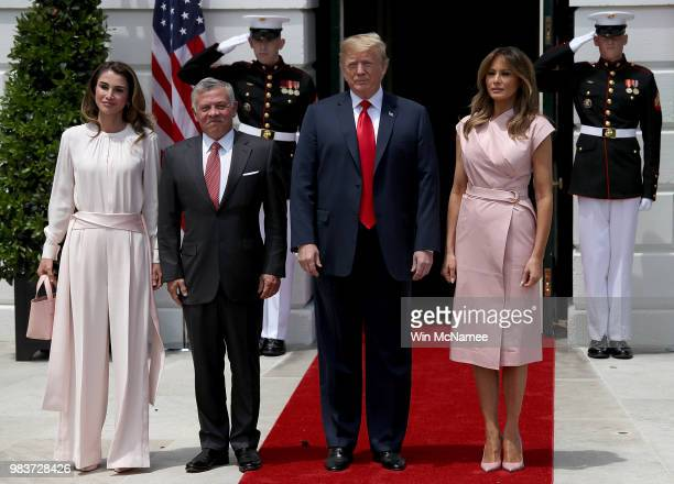 S President Donald Trump and first lady Melania Trump welcome King Abdullah of Jordan and Queen Rania to the White House June 25 2018 in Washington...