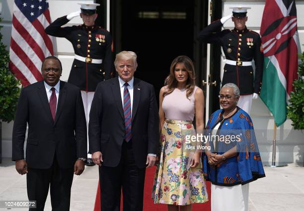 S President Donald Trump and first lady Melania Trump welcome President Uhuru Kenyatta of Kenya and his wife Margaret Gakuo during a South Portico...