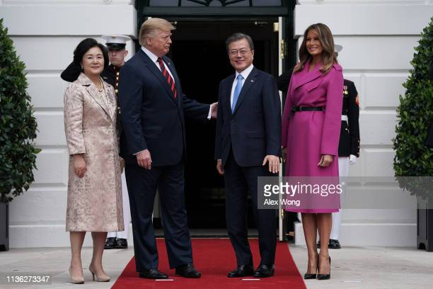 President Donald Trump and first lady Melania Trump welcome South Korean President Moon Jae-in and his wife Kim Jung-sook at the South Portico of the...