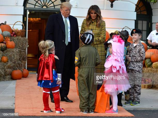President Donald Trump and First Lady Melania Trump welcome trickortreaters to the White House for Halloween festivities October 28 in Washington DC