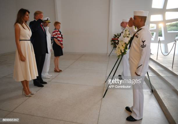 US President Donald Trump and First Lady Melania Trump with Admiral Harry B Harris Jr Commander US Pacific Command and his wife Bruni Bradley...
