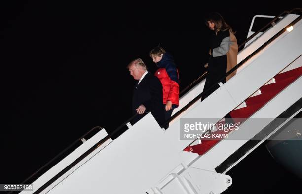 US President Donald Trump and First Lady Melania Trump with their son Barron arrive at Joint Base Andrews in Maryland on January 15 2018 / AFP PHOTO...