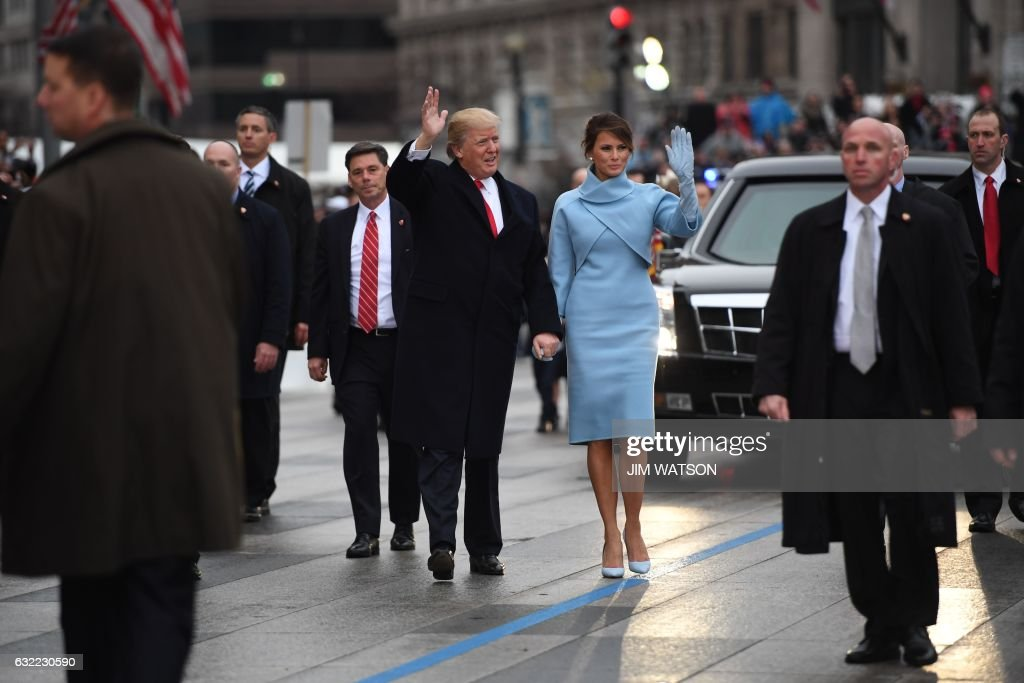 US President Donald Trump and First Lady Melania walk the inaugural parade route with son Barron (R) on Pennsylvania Avenue in Washington, DC, on January 20, 2017 following swearing-in ceremonies on Capitol Hill earlier today. WATSON