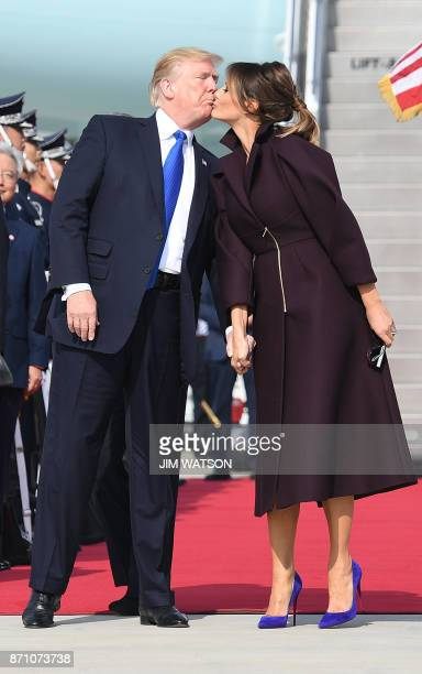 President Donald Trump and First Lady Meliana kiss upon arriving in Osan on November 7 2017 Donald Trump's marathon Asia tour moves to South Korea...