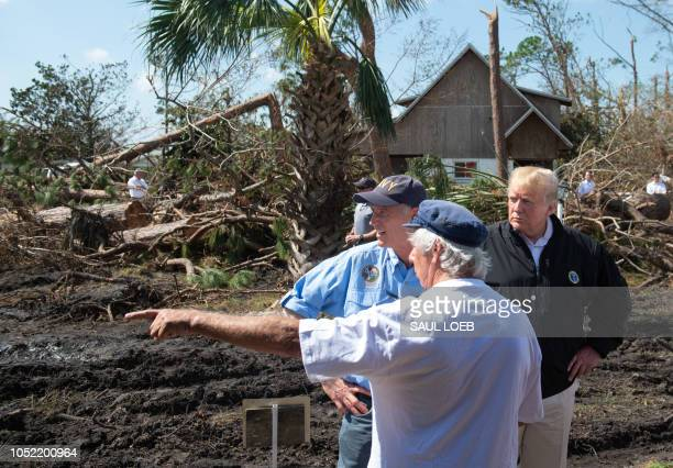 US President Donald Trump and Florida Governor Rick Scott tour damage from Hurricane Michael in Lynn Haven Florida October 15 2018