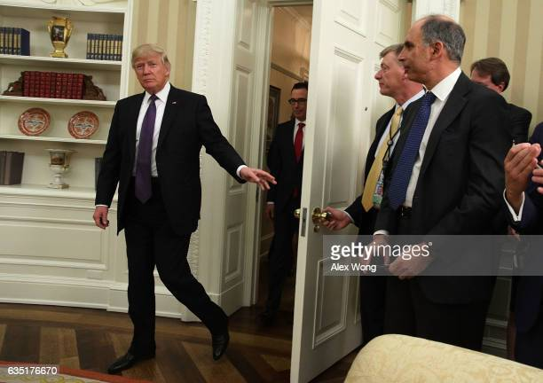 S President Donald Trump and former investment banker for Goldman Sachs Steven Mnuchin enter the Oval Office of the White House for a swearingin...
