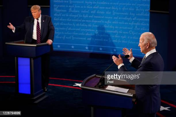 President Donald Trump and former Vice President and Democratic presidential nominee Joe Biden speak during the first presidential debate at the...