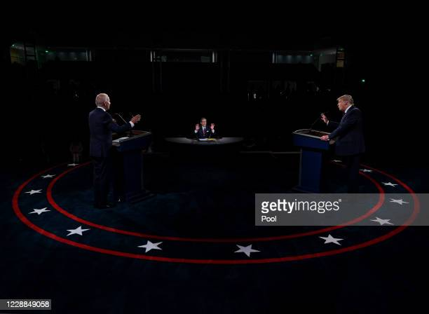 President Donald Trump and former Vice President and Democratic presidential nominee Joe Biden participate in the first presidential debate at the...