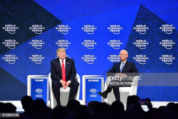 US President Donald Trump and Founder and Executive Chairman of the World Economic Forum Klaus Schwab speak during a discussion following Trump's...