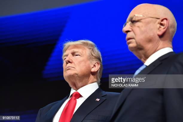 US President Donald Trump and Founder and Executive Chairman of the World Economic Forum Klaus Schwab listen during a ceremony before addressing the...