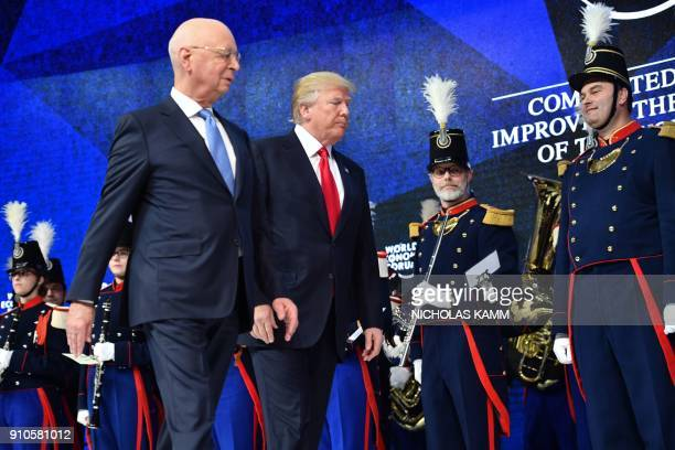 US President Donald Trump and founder and Executive Chairman of the World Economic Forum Klaus Schwab arrive to address the World Economic Forum...