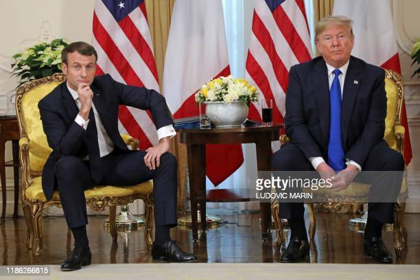 President Donald Trump and France's President Emmanuel Macron react as they talk during their meeting at Winfield House London on December 3 2019...
