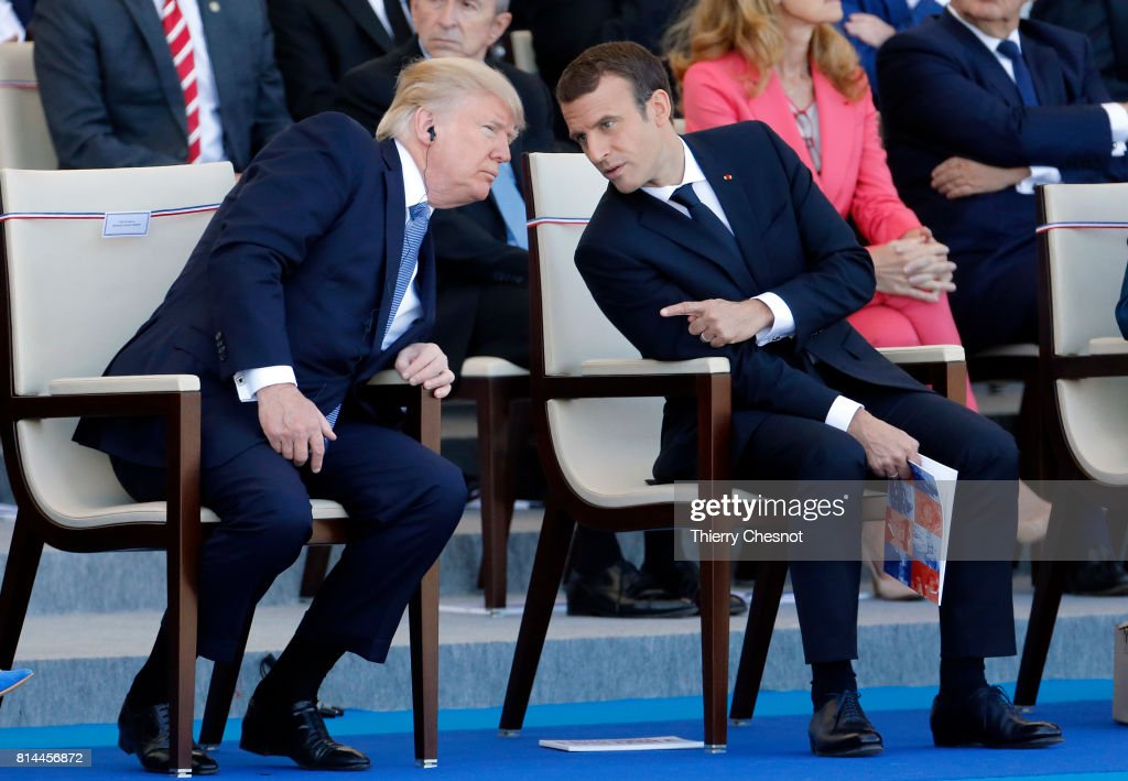 President Donald Trump and French President Emmanuel Macron attend the traditional Bastille day military parade on the Champs-Elysees on July 14, 2017 in Paris France. Bastille Day, the French National day commemorates this year the 100th anniversary of the entry of the United States of America into World War I.