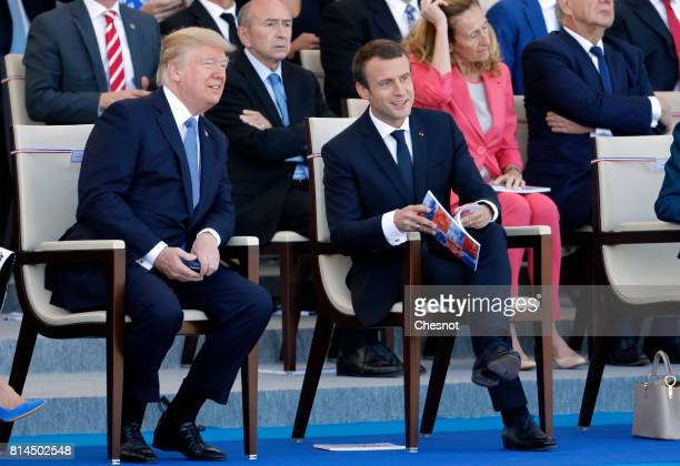 President Donald Trump and French President Emmanuel Macron attend the traditional Bastille day military parade on the ChampsElysees on July 14 2017...
